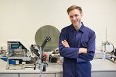 image of mechanical engineer  - Engineering student smiling at camera at the university - JPG