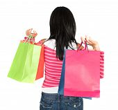 girl in pink holding shopping bags