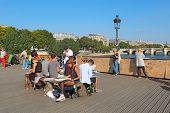 Art Students On The Pont Des Artes In Paris, France