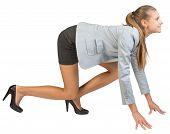 picture of start over  - Businesswoman standing in running start pose - JPG