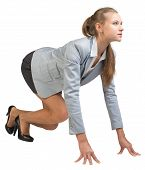 Businesswoman standing in running start pose