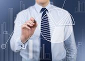 Businessman Drawing Analytics Symbol