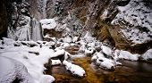 view of Casoca waterfall in winter, Buzau county, Romania