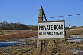 stock photo of scoria  - A sign warns motorists in the oil country that their driveway is a private road - JPG