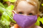 Cute Little Girl In Bright Face Mask