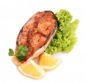 Tasty baked fish isolated on white