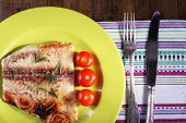 stock photo of pangasius  - Dish of Pangasius fillet with rosemary and cherry tomatoes in plate on wooden table background - JPG