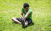 Stretching On The Grass