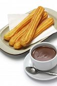 pic of churros  - churros and hot chocolate on white background - JPG