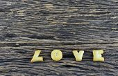 Love Cookies Alphabet On Wooden Background