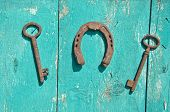 Two Old Rusty Historical Key And Luck Symbol Horseshoe On  Wall