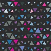 Seamless pattern of triangles, pink and blue on black background. Vector