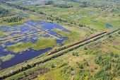picture of boggy  - Aerial view of bog landscape and train with turf - JPG