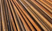 foto of reinforcing  - Stack of the metal rusty reinforcement bars - JPG
