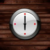 watch on a wooden wall