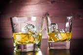 Drink Series, Glasses Of Whiskey With Ice On Old Wood Table
