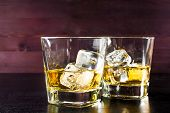 Drink Series, Two Glasses Of Whiskey With Ice On Old Wood Table