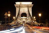 Szechenyi Chain Bridge at night with cars Budapest