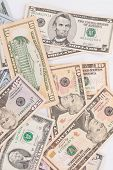 Heap of different dollar bills.