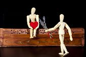 Wooden dummies with red heart and lavender