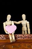 Wooden model with pink heart