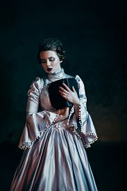 picture of dungeon  - Woman in victorian dress imprisoned in a dungeon - JPG