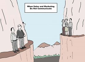 foto of not talking  - Cartoon showing two groups of business people on opposing cliffs not talking or interacting and the sign says when sales and marketing do not communicate - JPG