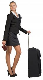 foto of passport cover  - Businesswoman with wheeled travel bag and passport with blank cover - JPG