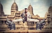 picture of karate  - Karate fighter does the splits - JPG