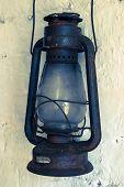 foto of kerosene lamp  - A close up of an old rusty kerosene lamp  - JPG