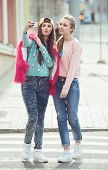 pic of  friends forever  - Hipster girlfriends taking a selfie in urban city context - JPG