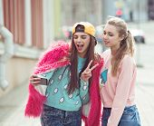 foto of  friends forever  - Hipster girlfriends taking a selfie in urban city context - JPG