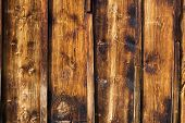 pic of lumber  - Exterior wooden rustic wall covered with paneling made of vertical lumber boards traditional architectural detail from Thyon Swiss Alps Valais close - JPG