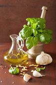 picture of pesto sauce  - ingredients for pesto sauce over wooden rustic background - JPG