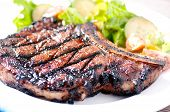 foto of rib eye steak  - a rare rib steak cooked to perfection on the grill - JPG