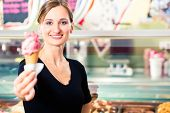 pic of ice cream parlor  - Sales girl portion a ball of ice cream to wafer - JPG