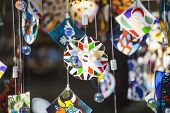 image of chimes  - Colorful glass wind chime hanging outside - JPG