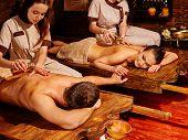 image of panchakarma  - Couple  having stone Ayurveda spa treatment - JPG
