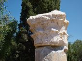 foto of ionic  - Details of a Corinthian Greek Ionic Roman Classical Marble Column with sky background - JPG