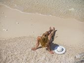 pic of shipwreck  - Woman relaxing on the famous Shipwreck Navagio beach in Zakynthos Greece - JPG