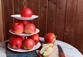 picture of serving tray  - Tasty ripe apples on serving tray on wooden background - JPG