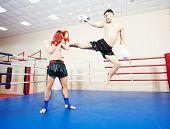 stock photo of muay thai  - muai thai sportsman fighting at training boxing ring - JPG