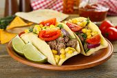pic of tacos  - Mexican food Taco in clay plate on wooden table - JPG