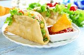stock photo of tacos  - Tasty taco with tomato dip on plate on table close up - JPG