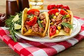 stock photo of tacos  - Mexican food Tacos in plate on napkin - JPG