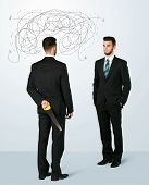 image of backstabbers  - Ruthless businessman hiding a weapon and weaving plan around his head - JPG