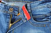 picture of zipper  - Zipper detail and the front pocket of pants in jeans for men light blue color - JPG