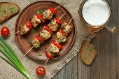 pic of kebab  - Delicious roasted turkey or chicken kebab skewers meat barbecue on clay dish with tomatoes - JPG