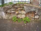 picture of fragmentation  - Fragment of old stone wall with wide angle fisheye view - JPG