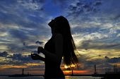 foto of humility  - summer beautiful girl at sunset on the sea - JPG